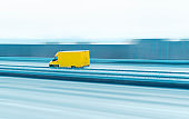 Delivery truck on the highway. Yellow van in motion