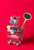 Shopping cart full of gift boxes. Gift shopping concept. Christmas sale