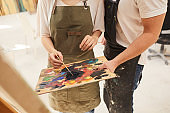Couple Painting Picture Together Close Up