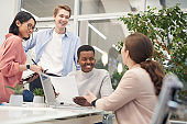 Cheerful Young People in Business Meeting