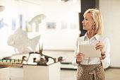 Elegant Woman Managing Art Gallery Exhibition