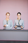 Two Women at Check In Desk in Airport