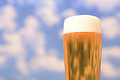 Glass beer in the blue sky