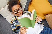 Smart African Boy Reading Book