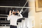 Bearded Man Using VR in Art Gallery