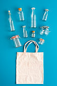 Plastic-free containers for groceries. Glass bottles and jars top view
