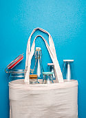 Nonplastic containers for storage and shopping. Cotton bag with glass bottles and jars