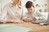 Boy Studying at Home with Mom