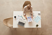Businesswoman at Desk Above View