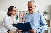 Senior Patient Reading Diagnosis