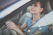 Pretty, young woman driving a car