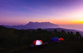 Colorful twilight sky before sunrise at outdoor camping site with camping tents.