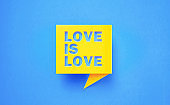 Love Is Love Written Yellow Chat Bubble on Blue Background