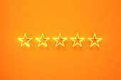 Five Star Written by Yellow Neon Light on Yellow Background