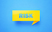 Risk Written Yellow Chat Bubble on Blue Background