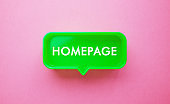 Green Speech Bubble with Homepage Text on Pink Background