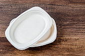 Biodegradable dish on wooden background