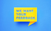 We Want Your Feedback Written Yellow Chat Bubble on Blue Background