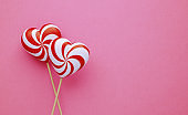 Valentine's Day Concept- Heart Shaped Lollipops on Pink Background