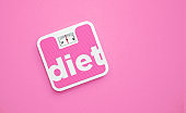 Diet Written Pink Bathroom Scale on Pink Background