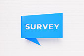 Survey Written Blue Chat Bubble on White Background