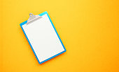 Blue Clipboard on Yellow Background