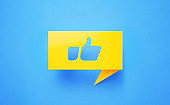 Thumbs Up Icon Drawn Yellow Chat Bubble on Blue Background
