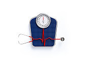 Red Stethoscope Forming Pulse Trace over  Blue Bathroom Scale on White Background
