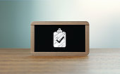 Wooden Framed Blackboard with Survey Icon Sitting over Wooden Surface