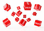 New Year Concept - 2021 Written Red Cubes are Falling over White Background