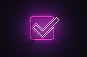 Check Mark Symbol Drawn by Purple Neon Light on Black Wall