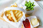 Tasty french fries with ketchup and sauce