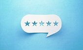 Five Stars Drawn White Chat Bubble on Blue Background