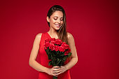 Happy smiling woman with roses bouquet.