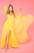 Beautiful lady in flowing yellow dress.