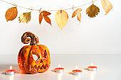 Pumpkin lantern jack and burning candles. Halloween composition. Home decor