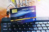 Online payment credit card on keyboard and shopping cart background / shopping online technology and credit card payment