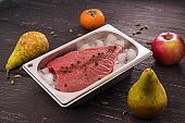 fresh meat with spices in ice