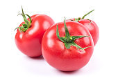 Red fresh tomatoes isolated on white background in close-up