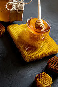 Healthy Thick honey dipping from the wooden honey spoon, bee products by organic natural ingredients concept