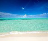 tropical beach in Maldives and blue lagoon. Sea landscape