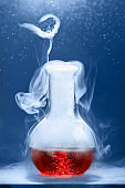 Chemical reaction in volumetric flask glass in labolatory. The concept of scientific experiments.