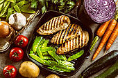 Grilled chicken breast in grill pan with sweet peas and seasoning vegetable