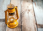 Vintage Yellow Rusted Lantern on Wooden Board