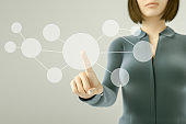 Business woman pressing button on touch screen