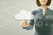 Business woman pressing button on touch screen, cloud computing concept