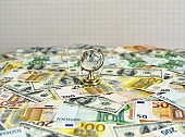 Globe on the desk and euro and dollar banknotes. Money and globus on the desk. Travel and money concept