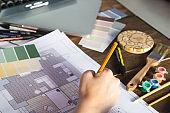 Interior designer draws a plan with art tools