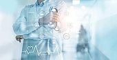 Healthcare and medical concept. Medicine doctor with stethoscope in hand with icon medical network and patients come to the hospital background.