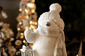 beautiful figurine of white toy penguin with little flashlight